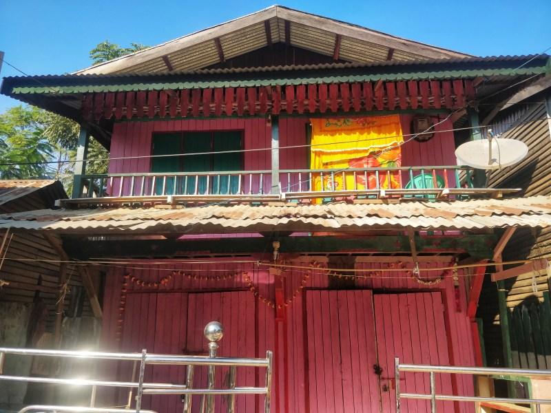 A rare painted wooden houses in Tamu, Myanmar