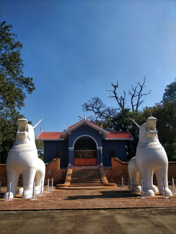A pair of 'Kangla Sha' - dragons at the fort premises, guardians of the coronation hall in background