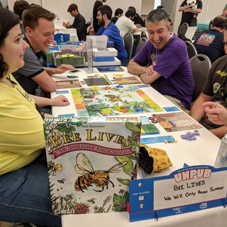 3 players working out their moves in a game of Bee Lives