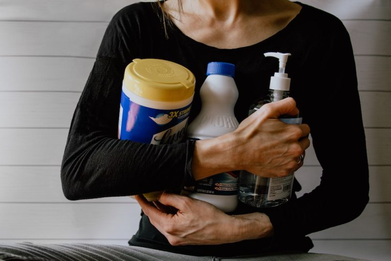 women holding cleaning supplies