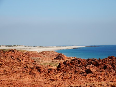 Where red earth meets the blue sea