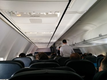 Economy cabin during drink service