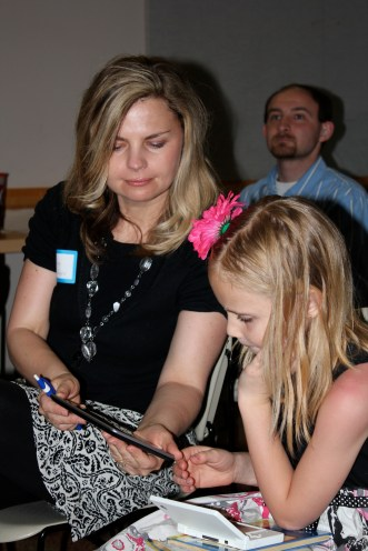 Shanna & daughter admiring the new device