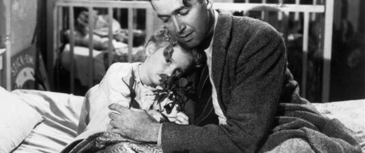 """George Bailey from """"It's a Wonderful Life"""" hugs his daughter Susan."""