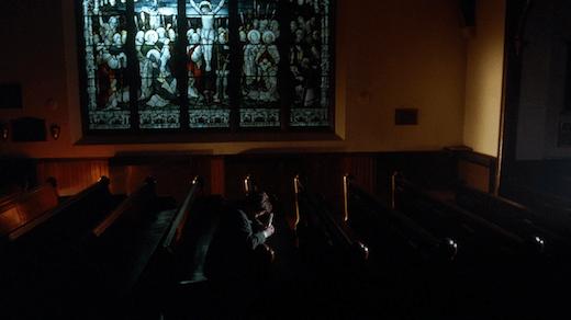 Mulder cries in a church