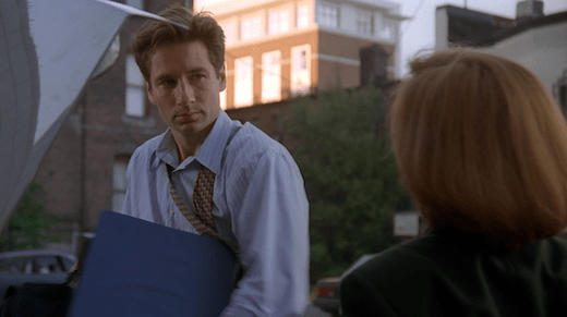 Mulder looks down at Scully.