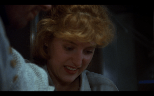 Scully grimaces as she catches sight of the worm in Bear's neck.