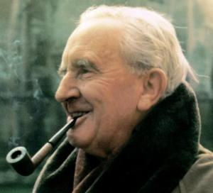 J.R.R. Tolkien smiles and smokes his pipe.