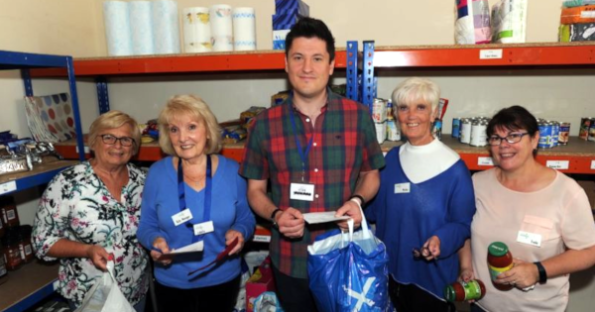 Ged with some of the foodbank volunteers. (Picture courtesy of the Rutherglen Reformer).