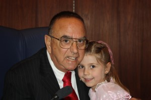 Newly installed Norwalk Mayor Luigi Vernola shares a special moment with his granddaughter. Randy Economy Photo