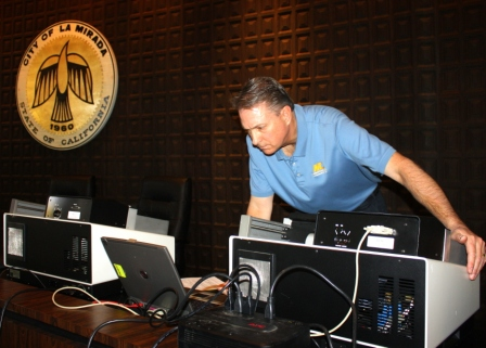 A representative from Martin and Chapman works to try to find glitches in voting tabulation machines. Randy Economy Photo