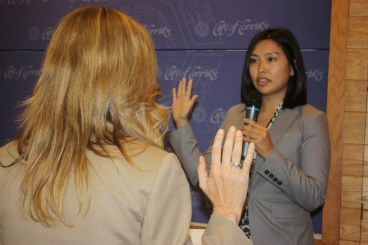 : New Planning Commissioner Tatiana Yokoyama takes oath of office from Cerritos City Clerk Vita Barrone at Monday's city council meeting.  Randy Economy Photo