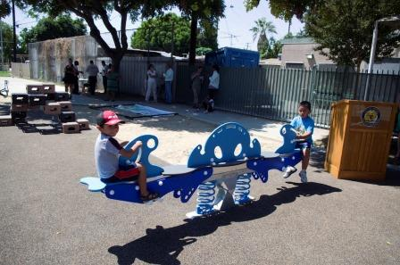 "Kids play on the new ""See Saw"" at Padleford Park in Artesia.  Kristin Grafft Photo and Article"