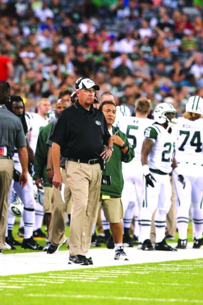 La Mirada Assistant Coach and RSP Teacher Ernie Gutierrez, right, watches as the New York Jets play the Jacksonville Jaguars with Jets Head Coach Rex Ryan. PHOTO CREDIT: New York Jets/Al Pereira