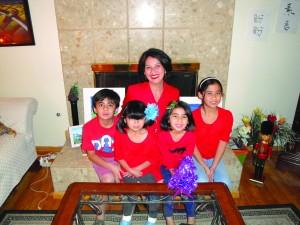 Dr. Irella Perez celebrates the Christmas holiday with her four children at their Whittier home.  Tammye McDuff Photo.
