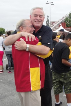 ": Downey City Councilman Mario Guerra is ""all hugs"" at the annual ARC Walk in Downey.  Tammye McDuff Photo"