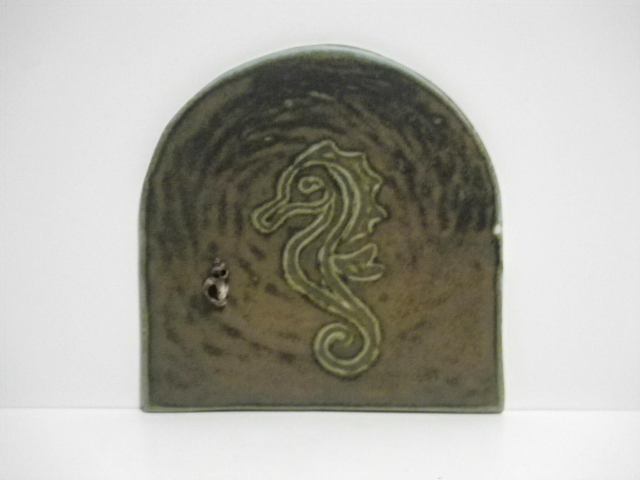 five inch green-brown seahorse door with shell doorknob