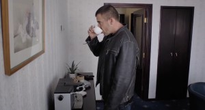 Hazen (played by Dominic Purcell) drinks a cup of coffee