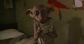 Dobby the house-elf in Harry Potter's room.