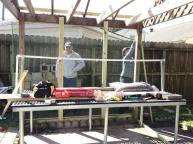 Building the greenhouse over the growing bench on loan from Katy Prairie Conservancy.