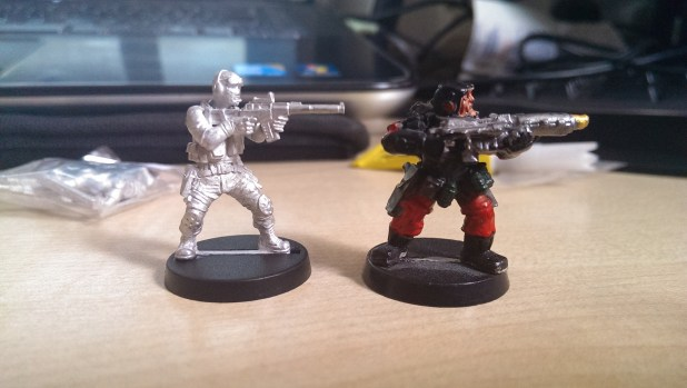 Assembled VAL figure next to Citadel Miniatures Storm Trooper