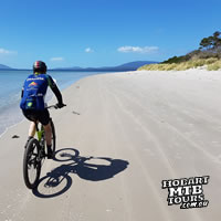 Beach biking in Tasmania