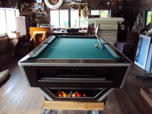 The upstairs of the workshop, with pool table and other trinkets.