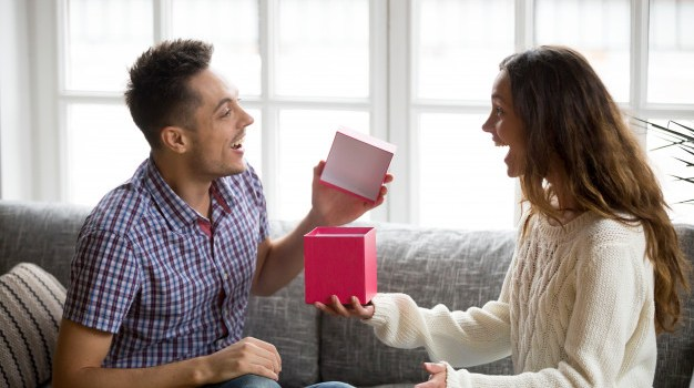 Excited Young Man Opening Gift Box Receiving Present From Wife 1163 4818