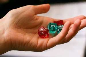 Image of hand holding a dice set