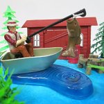 Gone-Fishing-Fisherman-Themed-Birthday-Cake-Topper-Set-Featuring-Camping-Angler-in-Boat-with-Decorative-Themed-Accessories-0-0