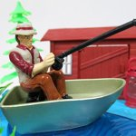 Gone-Fishing-Fisherman-Themed-Birthday-Cake-Topper-Set-Featuring-Camping-Angler-in-Boat-with-Decorative-Themed-Accessories-0-1