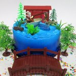 Gone-Fishing-Fisherman-Themed-Birthday-Cake-Topper-Set-Featuring-Camping-Angler-in-Boat-with-Decorative-Themed-Accessories-0
