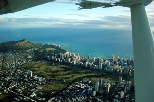 Our first glimpses of Waikiki on our puddle jumper over from Molokai. In the group of tall building by the shore (Waikiki), the building we living in during 2010 is the furthest to the left.