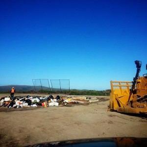 Up at the Molokai Dump, the bulldozer gets ready to turn trash into a mountain.