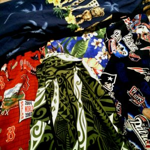 """A few of my Aloha Shirts. Flowers and tikis are culturally appropriate. The Red Sox Aloha Shirt is not culturally appropriate unless you are dressing up as two-time World Series Winner Shane Victorino, """"The Flyin' Hawaiian""""."""
