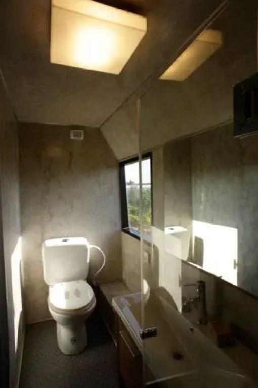 toilet over rear wheel city bus tiny house