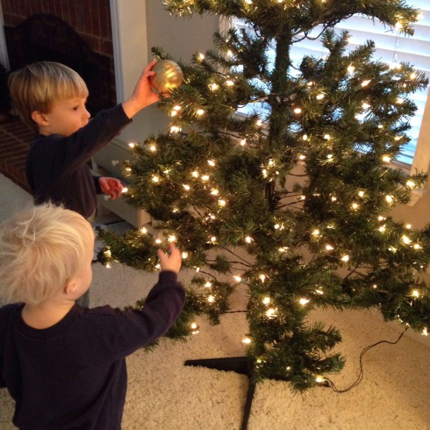 boys decorating tree
