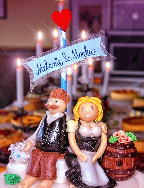 Hochzeitsfotos - Schöne und lüstige Hochzeitstorte