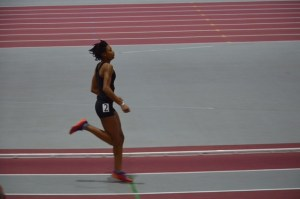 Coutee-McCullum crosses the finish line in a 200 meter dash.