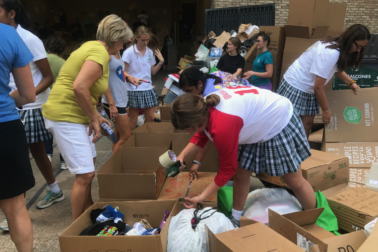 Senior Katherine Pollock and other Hockaday students help sort donations with the Trusted World Organization