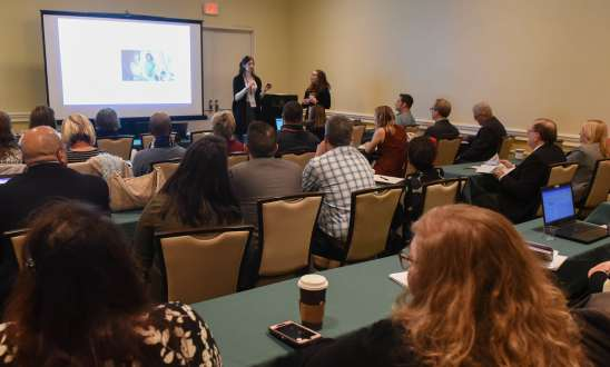 Aidan and Casey presenting a social media advertising presentation