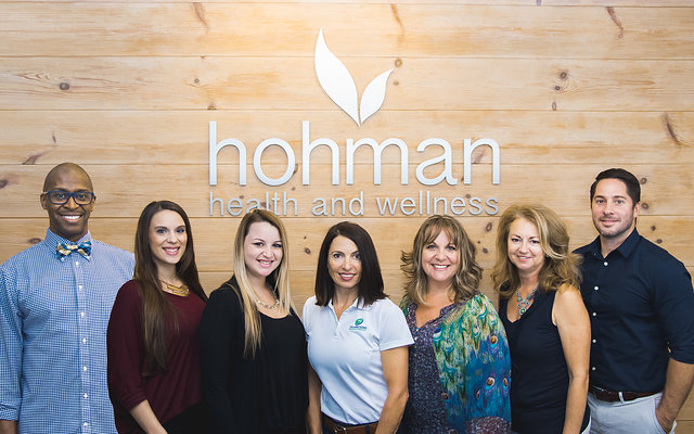 The Hohman team posing in their office