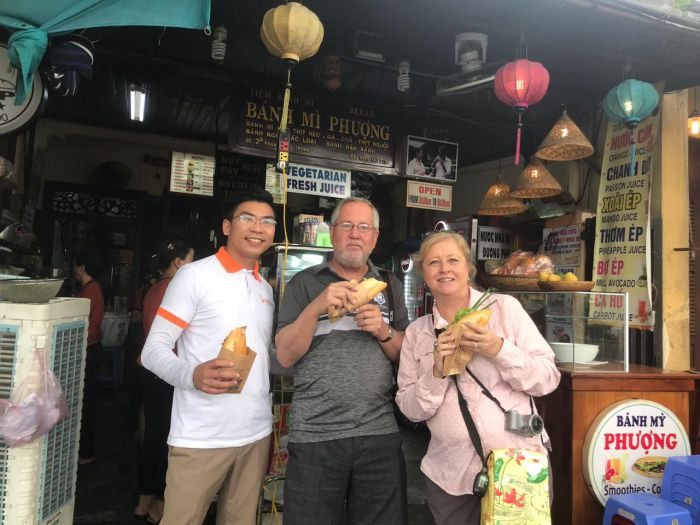 Hoi An Private Driver with sweet couple at Phuong Bread, Hoi An Old town