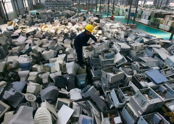 An employee arranges discarded computers at a newly opened electronic waste recycling factory in Wuhan, Hubei province March 29, 2011. According to the U.S. Environmental Protection Agency (EPA), e-waste is the fastest growing commodity in the waste stream, with a growth rate five times that of other parts of the business such as industrial waste. The burgeoning middle classes in fast-growth China and India mean there are more computers and mobiles, adding to e-cycling growth. REUTERS/Stringer (CHINA - Tags: ENVIRONMENT IMAGES OF THE DAY BUSINESS SCI TECH) CHINA OUT. NO COMMERCIAL OR EDITORIAL SALES IN CHINA. BEST QUALITY AVAILABLE - RTR2KJOE