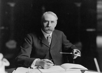 British composer Edward Elgar (1857 - 1934) seated at his desk at Severn House in Hampstead. (Photo by Reginald Haines/Getty Images)