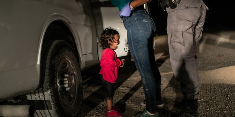 A two-year-old Honduran asylum seeker cries as her mother is searched and detained near the U.S.-Mexico border on June 12, 2018 in McAllen, Texas. They had rafted across the Rio Grande from Mexico and were detained by U.S. Border Patrol agents before being sent to a processing center. The following week the Trump administration, under pressure from the public and lawmakers, ended its contraversial policy of separating immigrant children from their parents at the U.S.-Mexico border. Although the child and her mother remained together, they were sent to a series of detention facilities before being released weeks later, pending a future asylum hearing.
