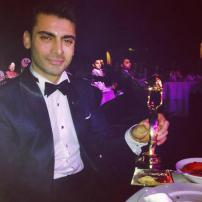 Fawad khan poses with his Award for best Bollywood Debut.