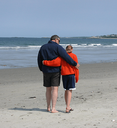 Kaiie and Dad on the beach in Hull Mass.  Between Soccer Games