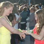 Lizzie and Kaitie compare corsages