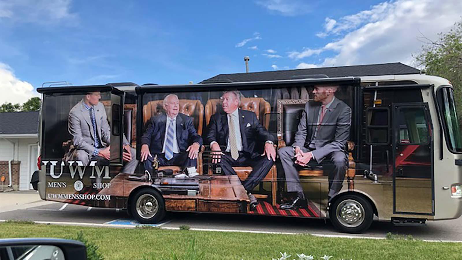 UMW Men's Shop bus. Fitting clients for suits